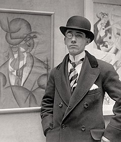 Gino Severini in 1913 at the opening night of his exhibition at the Marlborough Gallery, London (detail)