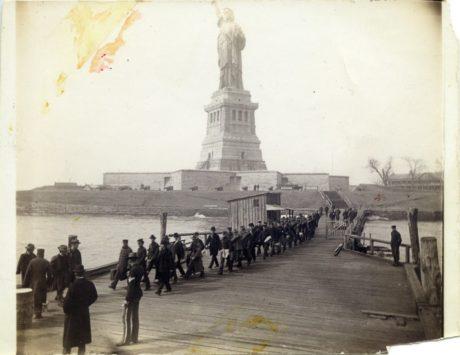 E. Alice Austen, [Line of Soldiers on Docks of Liberty Island], 1887.